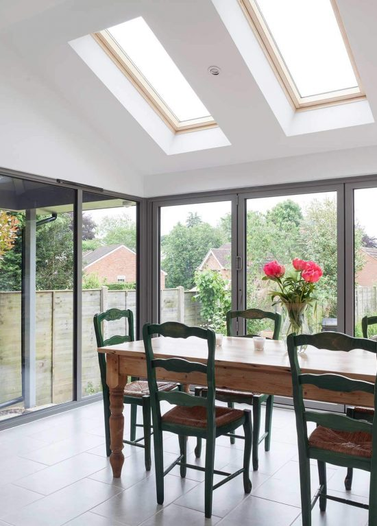 Wide span of aluminium bifold doors leading on to the patio area