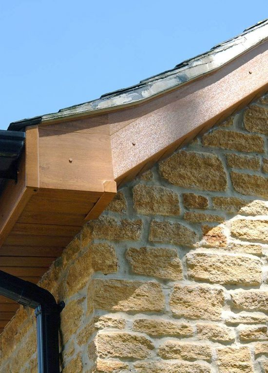Oak colour uPVC fascias and soffits with black guttering