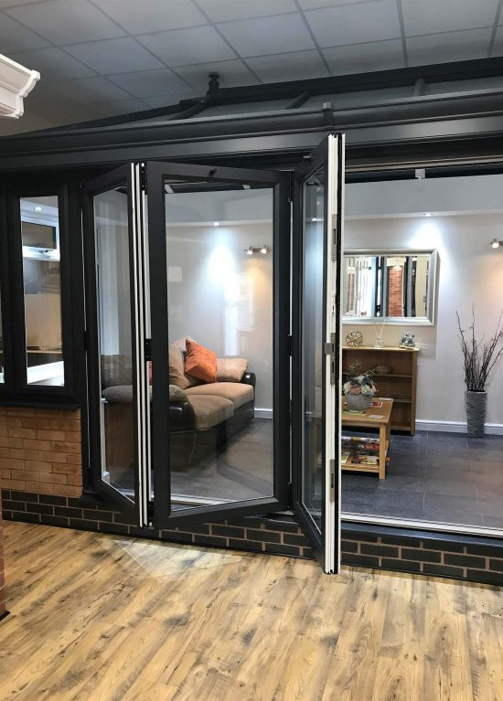 Black bifolding doors on demo in our showroom