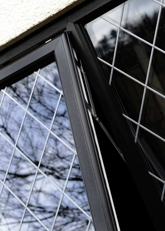 Black uPVC window with lead detail