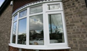 Bow style uPVC windows with decorative glass