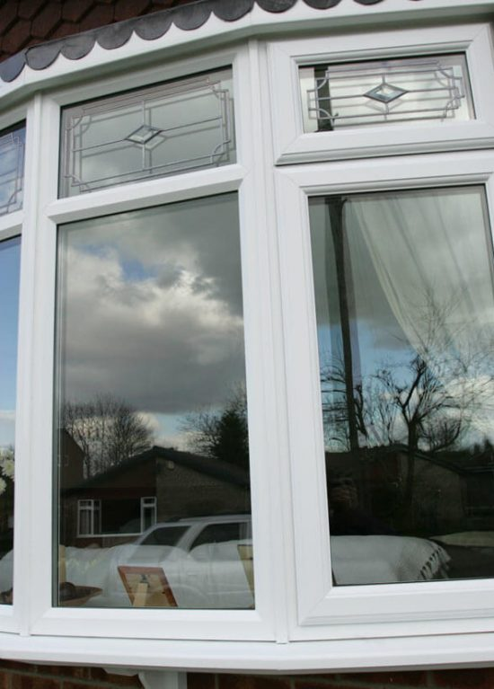 Bow style uPVC windows with decorative glass