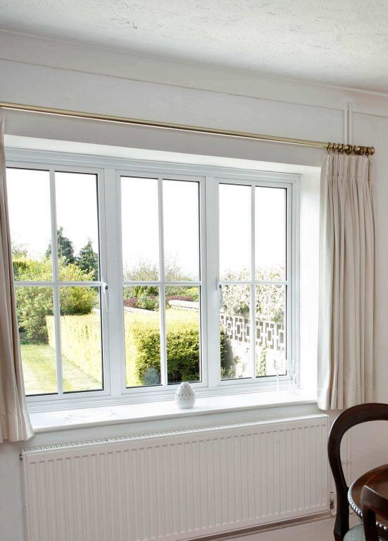 White aluminium windows in casement style