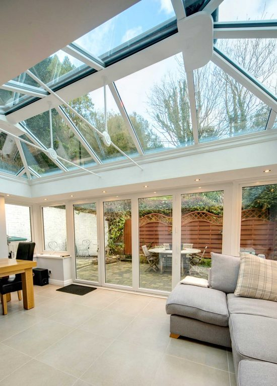 Modern conservatory interior with dining area and chill out area