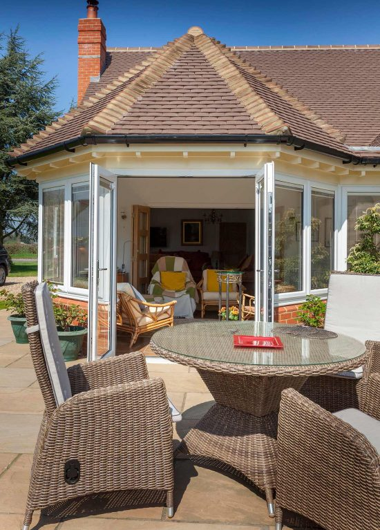 White french doors that open onto a patio area