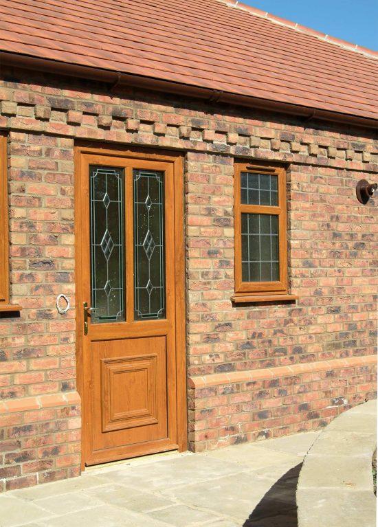 Golden oak colour uPVC entrance door with 2 glazed panels