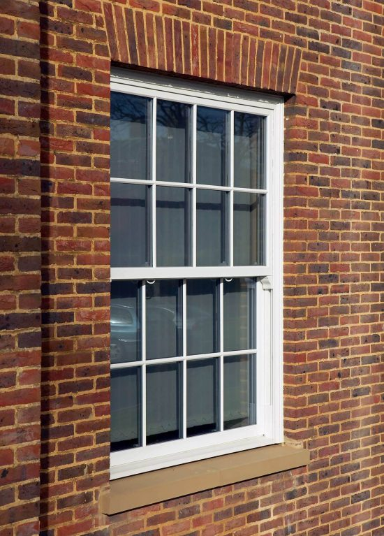 White vertical sliding sash windows with Georgian bars for an authentic look
