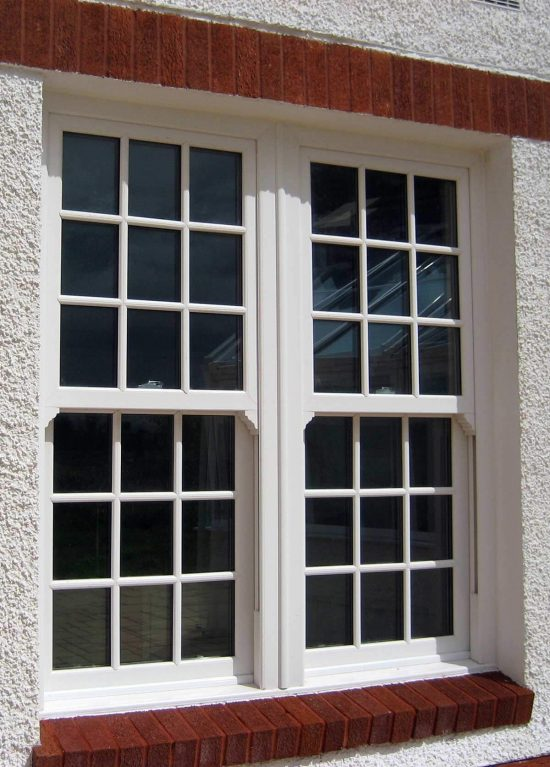 White uPVC windows that slide vertically