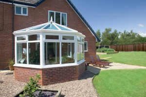 Conservatory with brick base and uPVC windows and doors