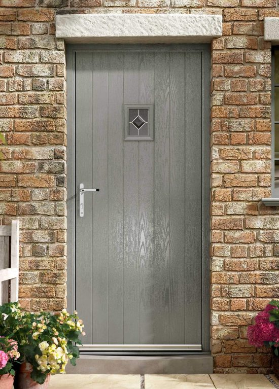 Grey cottage style entrance door with single square glazed pane