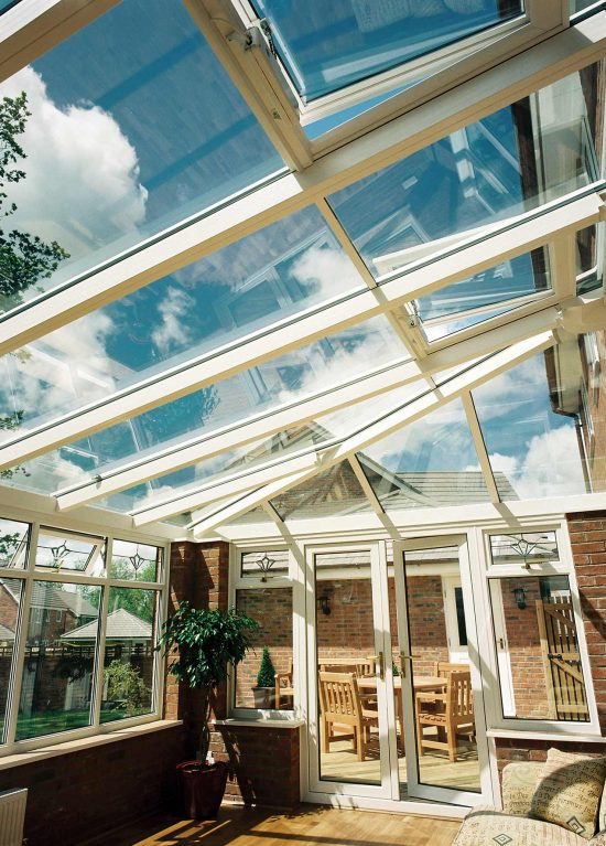 Hipped lean-to style conservatory with glass roof