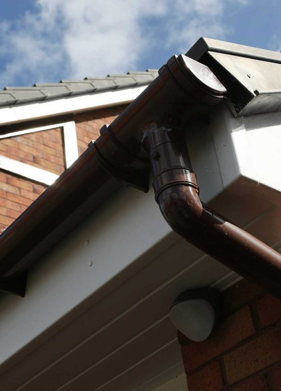 Rosewood colour guttering and white uPVC fascias and soffits