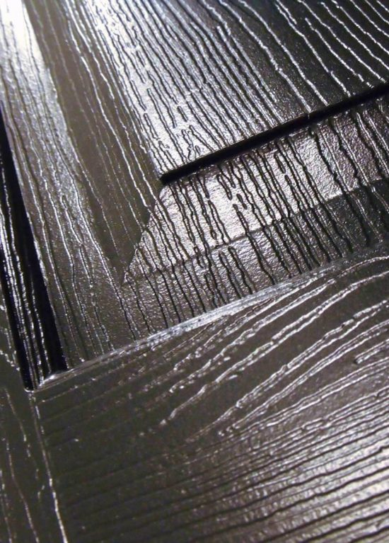 A close up look at the woodgrain finish on our Solidor composite doors