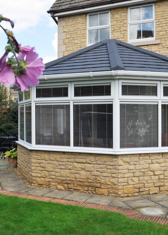 New conservatory installation with tiled roof