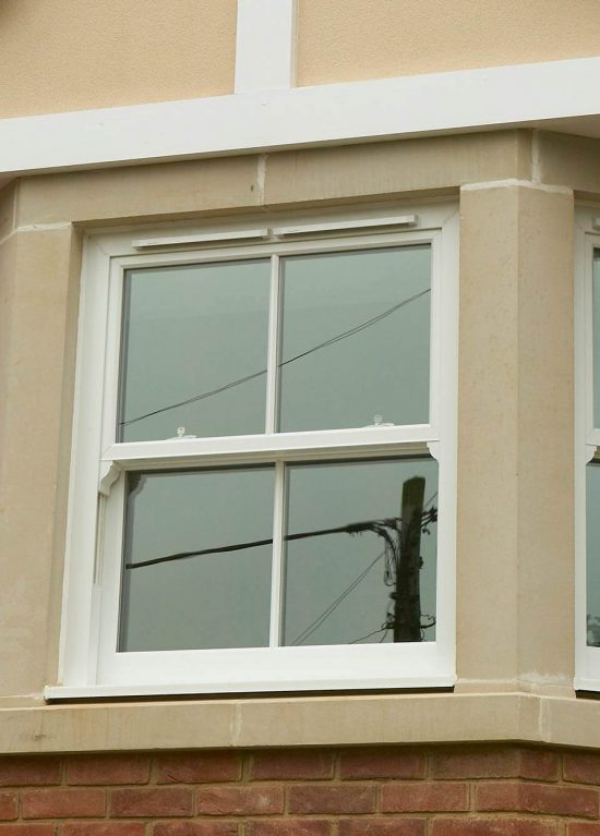 White traditional style uPVC sliding sash windows
