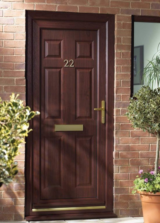 A rosewood colour door with gold furniture