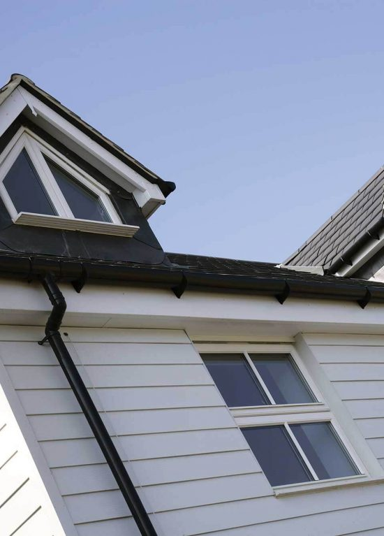 Black guttering with white uPVC soffits