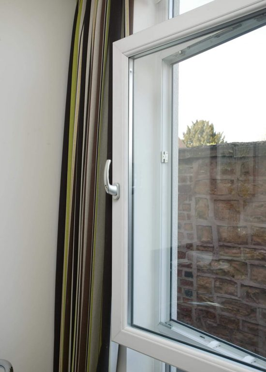 A uPVC tilting window with silver handle