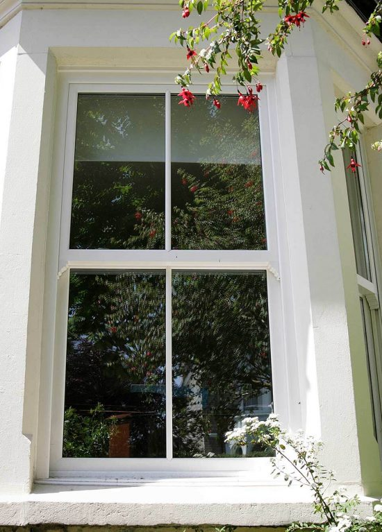 uPVC vertical sliding sash windows installed in a bay style arrangement