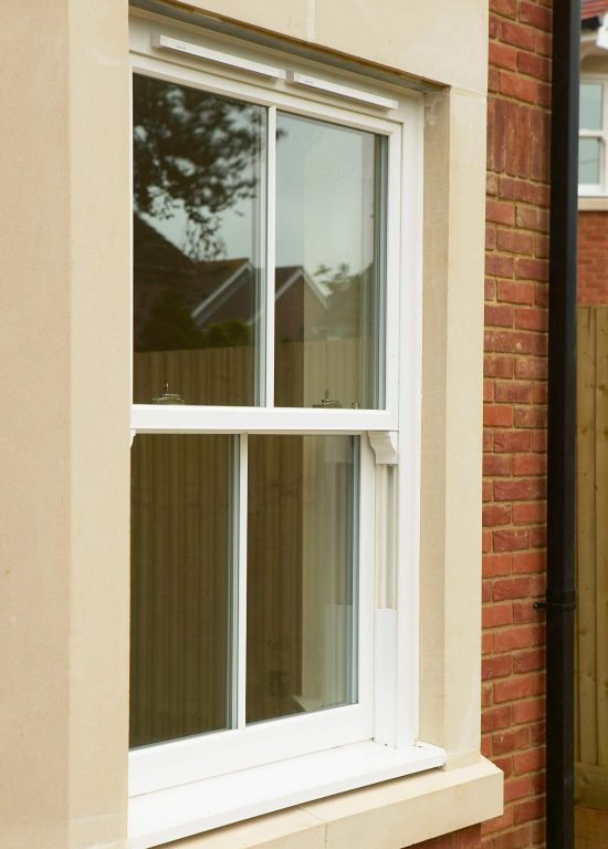 uPVC sliding sash window with mock sash horns