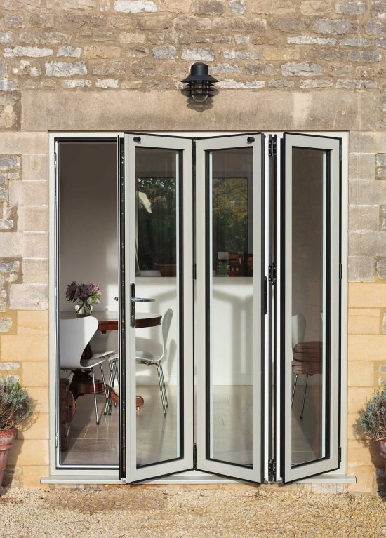 White aluminium bifold doors manufactured by Smart