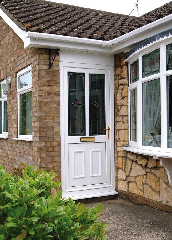 White uPVC entrance door with double glazed panels