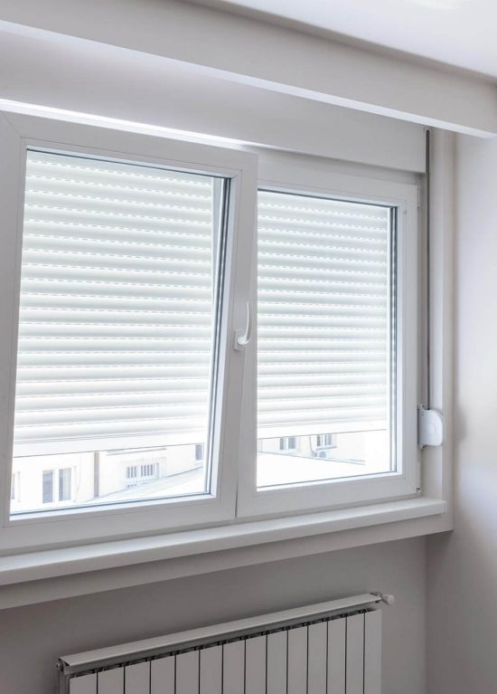 A white uPVC window with blinds